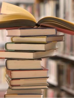 Bildresultat för book pile on the bedside table