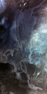Color sample of Dutch Blue, Interference Blue, Shimmering Black on black Artagain paper.