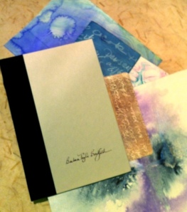 Surface decorated papers that will be re-worked into the cover of this recycled book.