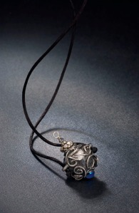 Vessel necklace, silver and glass cabochon, with removable lid. From my days as a silversmith.