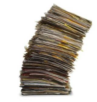 leaning-stack-of-papers-and-files