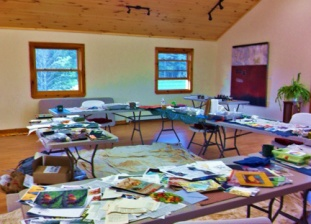 The work tables at last year's class. This year's will be just as filled with papers, colors and idea.
