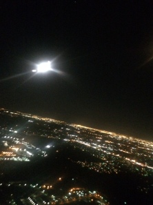 Moonrise over Houston. The bright full moon is caught under the wing, as we turn west toward Phoenix.