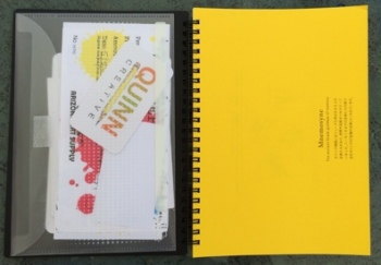 Open notebook showing yellow first page (others are white) and pocket insert that does NOT come with the notebook.