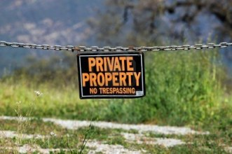 9168751-black-orange-white-private-property-hanging-sign