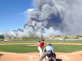 It's not rain, but a forest fire behind a high-school game in Colorado. I found it randomly.