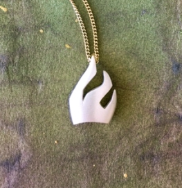 The Letter Shin, © photograph by Quinn McDonald. Sterling pendant by Su Keates.